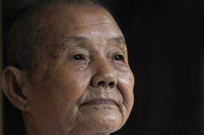 In this July 3, 2014 photo, Som Seng Eath, 86, widow of a dairy writer Poch Younly, pauses during an interview with the Associated Press in her home, in Phnom Penh, Cambodia. Nearly 40 years ago, Cambodian school inspector Poch Younly kept a secret diary vividly recounting the horrors of life under the Khmer Rouge, the radical communist regime whose extreme experiment in social engineering took the lives of 1.7 million Cambodians who died of overwork, medical neglect, starvation and execution. Photo: AP