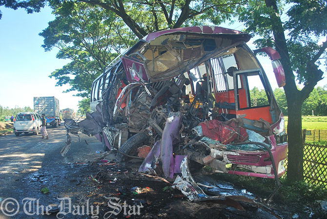 The wrecked bus that collided head on with a truck on Dhaka-Chittagong highway in Sitakunda on Friday. Photo: Star