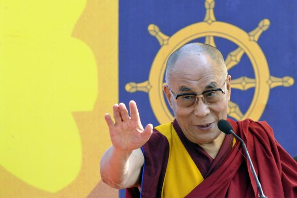 Exiled Tibetan spiritual leader, the Dalai Lama, addresses a gathering with the theme ''A Human Approach to Peace and the Individual'' at a stadium in the northeastern Indian city of Guwahati February 2, 2014.