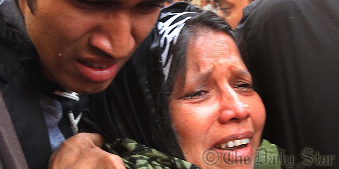 Family of Deen Mohammad, one of the convicts of 10-truck arms haul case who has received death penalty verdict, break down in tears after the verdict outside the Chittagong court premises today. Photo: Anurup Kanti Das