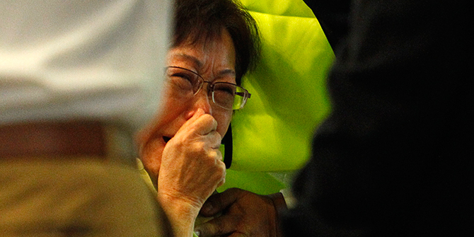 Malaysian Siti Dina weeps after seeing her daughter's name on the list of passengers on board Malaysia Airlines MH17 at Kuala Lumpur International Airport in Sepang July 18, 2014. Her daughter Shelisa Zaini, Shelisa's Dutch husband and their three children were on board the plane en-route to Melbourne, Australia. Photo: Reuters