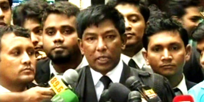 Defence counsel Faruque Ahmed briefs media at the court premises. Photo: TV grab