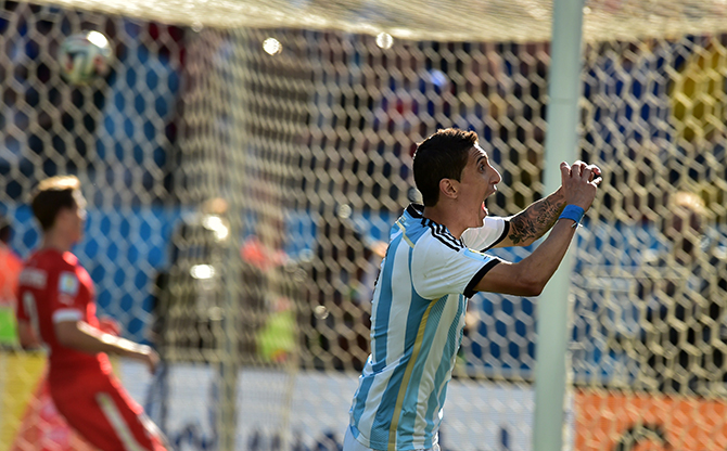 Argentina's midfielder Angel Di Maria celebrates after scoring the 1-0 during a Round of 16 football match between Argentina and Switzerland at Corinthians Arena in Sao Paulo during the 2014 FIFA World Cup on July 1, 2014. Photo: Getty Images