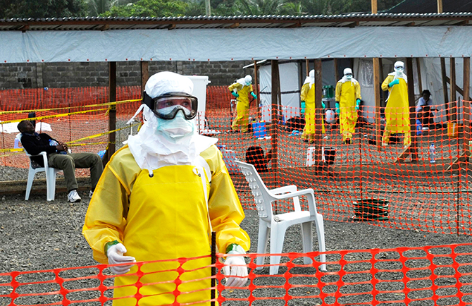Medicins Sans Frontieres (MSF) health workers prepare at ELWA's isolation camp during the visit of Senior United Nations (U.N.) System Coordinator for Ebola David Nabarro, at the camp in Monrovia August 23, 2014. Photo: Reuters