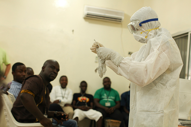 A Samaritan's Purse medical personnel demonstrates personal protective equipment to educate team members on the Ebola virus in Liberia in this undated handout photo courtesy of Samaritan's Purse. Photo: Reuters