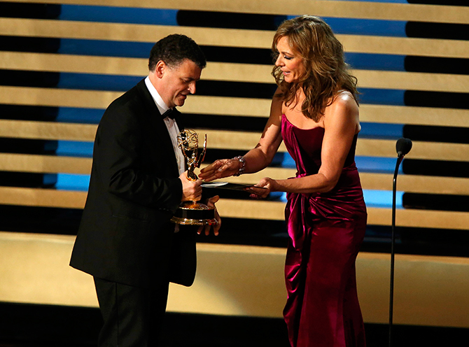 Allison Janney presents the award to Steven Moffat for Outstanding Writing for a Miniseries, Movie or a Dramatic Special for PBS