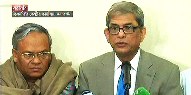 BNP acting secretary general Mirza Fakhrul Islam Alamgir flanked by party Joint Secretary General Rizvi Ahmed addresses at press conference at party headquarters in Nayapaltan of the capital on Monday. Photo: TV grab