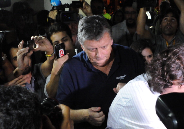 The CEO of Match Hospitality, a subsidary company of Fifa in charge of World Cup ticket packages, Raymond Whelan arrives at a police station in Rio de Janeiro after being arrested accused of leading a network that illegal sold game passes, on July 7, 2014 in Rio de Janeiro. Photo: Getty Images