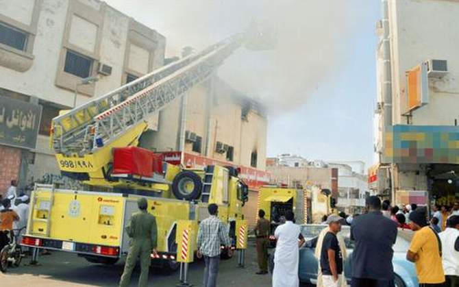 Civil Defense teams engage in fire extinguishing and rescue operations following a fire at a residential building in Jeddah's Jamia district on Friday. The photo is taken from Saudi Gazette news website.