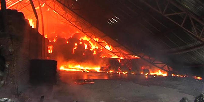 Fire engulfs the tin-shed building of Jaba Textile Mill in Brammandi area of Narsingdi town this morning. Photo: Star