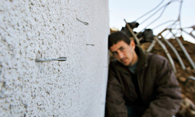 A image taken in 2009 of darts from a flechette shell embedded in a wall in Gaza. Photo: AP