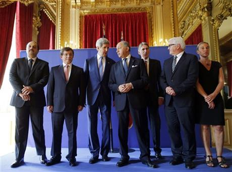 U.S. Secretary of State John Kerry, third from left, stands with from left, Qatari Foreign Minister Khaled al-Attiyah, Turkish Foreign Minister Ahmet Davutoglu, French Foreign Minister Laurent Fabius, British Foreign Secretary Philip Hammond, German Foreign Minister Frank-Walter Steinmeier and Italian Foreign Minister Federica Mogherini after their meeting regarding a cease-fire between Hamas and Israel in Gaza, Saturday. Photo: AP