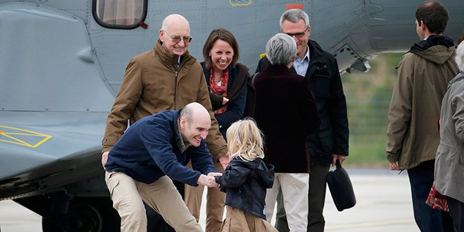 Nicolas Henin (L), former French hostage and journalist, is greeted by his family moments after the arrival of the ex-hostages by helicopter from Evreux to the military airbase in Villacoulbay, near Paris, April 20, 2014. Photo Reuters