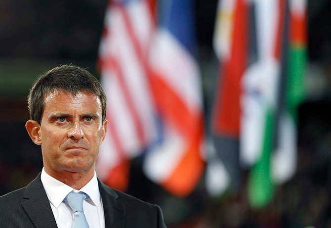 French Prime Minister Manuel Valls attends the opening ceremony of the world Equestrian Games at the d'Ornano stadium in Caen, August 23, 2014. Photo: Reuters