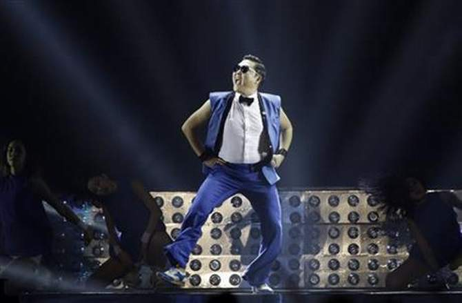 In this Sunday, December 22, 2013, file photo, South Korean rapper Psy performs during his concert