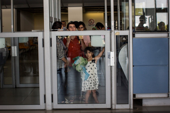 People wait to be let into Israel from Gaza during evacuations on the sixth day of Israel's operation 'Protective Edge' on July 12, 2014 in Erez, Israel. Photo: Getty Images