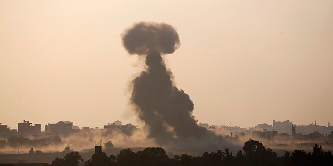 Smoke rises in the Gaza Strip after an Israeli strike August 3, 2014. An Israeli air strike killed 10 people and wounded about 30 on Sunday in a UN-run school in the southern Gaza Strip, a Palestinian official said, as dozens died in Israeli shelling of the enclave and Hamas fired rockets at Israel. Photo: Reuters