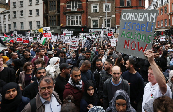 Pro-Palestinian demonstrators fill the street outside the Israeli embassy on July 11, 2014 in London, United Kingdom. Israel says it will resist international pressure to halt operations in Gaza. Photo: Getty Images
