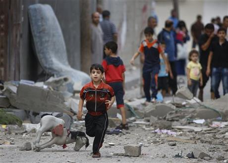 A Palestinian child runs on debris from a destroyed house, following an overnight Israeli strike in Beit Lahiya, in northern Gaza strip, Saturday. Photo: AP