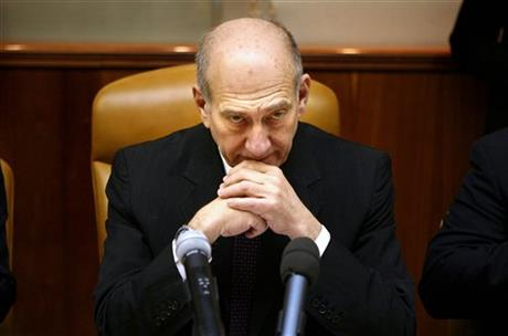 In this Sunday, Dec. 21, 2008, file photo, Israeli Prime Minister Ehud Olmert attends the weekly cabinet meeting in Jerusalem. The third Gaza war is playing out very much like the first one some five years ago: We are now at the stage where the harrowing civilian toll in Gaza is at the center of the discourse, eclipsing the rocket attacks by Hamas militants which are the reason for the Israeli assault. Photo: AP