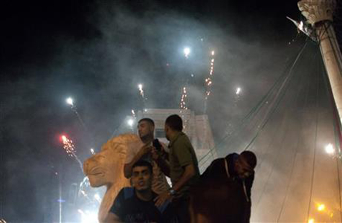 Palestinians launch fireworks during celebrations in the West bank city of Ramallah, late Sunday, July 20, 2014. Photo: AP