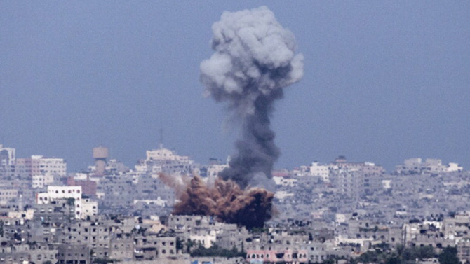 A picture taken from the southern Israeli-Gaza Strip border shows an explosion moments after an Israeli air strike on Gaza City on July 11. Photo: Getty Images