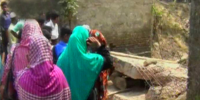 Local people gather near a collapsed under construction bridge at Barun village in Kapasia of Gazipur on Thursday. Four construction workers died and three others were injured when they were demolishing old bridge there. Photo: TV grab