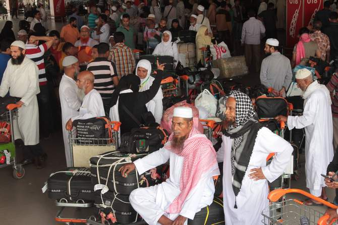 This October 28, 2013 photo shows a group of Hajj pilgrims waiting at Hazrat Shahjalal International Airport in Dhaka. Photo: Star