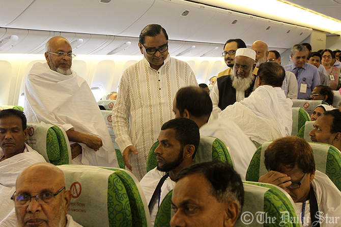 Civil Aviation Minister Rashed Khan Menon and Religious Affairs Minister Matiur Rahman along with Biman officials visit and bid farewell to the pilgrims in a Biman Hajj flight at Hazrat Shahjalal International Airport in Dhaka on Wednesday. Photo: SK Enamul Huq