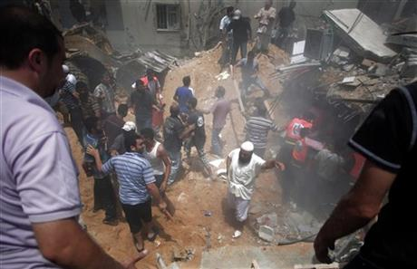 Palestinians search for survivors under the rubble of a house destroyed by an Israeli missile strike, in Gaza City, Monday. Photo: AP