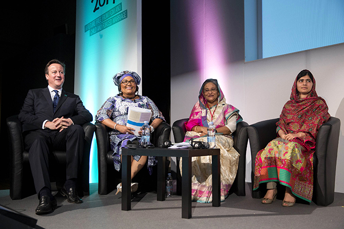 "Prime Minister Sheikh Hasina sits with British Prime Minister David Cameron, left, Chantal Compaore the First Lady of Burkina Faso, and Pakistani rights activist Malala Yousafzai, right, at the ""Girl Summit 2014"" at Walworth Academy in London on July 22."