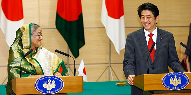 Bangladesh's Prime Minister Sheikh Hasina and Japan's Prime Minister Shinzo Abe smile after a joint news conference at Abe's official residence in Tokyo on Monday. Hasina is in Japan for a four-day visit. Photo: Reuters