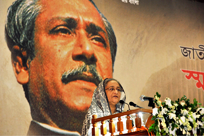 Prime Minister Sheikh Hasina addressing a discussion on National Mourning Day at Bangabandhu International Conference Centre on Saturday. Photo: BSS