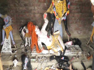 Vandalised idols of Hindu gods and goddesses lay scattered on the floor at Shashanghat Kali Mandir in Gopalpur of Netrakona on Friday. Photo: Star