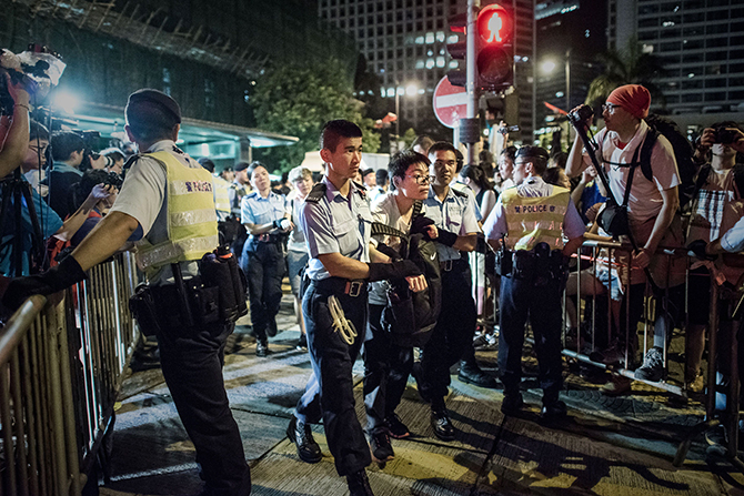 Policemen remove protesters in the central district after a pro-democracy rally seeking greater democracy in Hong Kong early on July 2, 2014 as frustration grows over the influence of Beijing on the city. Scores of protesters were forcibly removed by police in the early hours following a massive pro-democracy rally which organisers said saw a turnout of over half a million. Photo: Getty Images