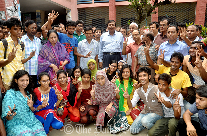 Jubilant students and teachers of Government Azizul Haque College in Bogra on Wednesday are celebrating their success in this year's Higher Secondary Certificate (HSC) and equivalent examinations. The college secured third position under Rajshahi Education Board. Photo: Star