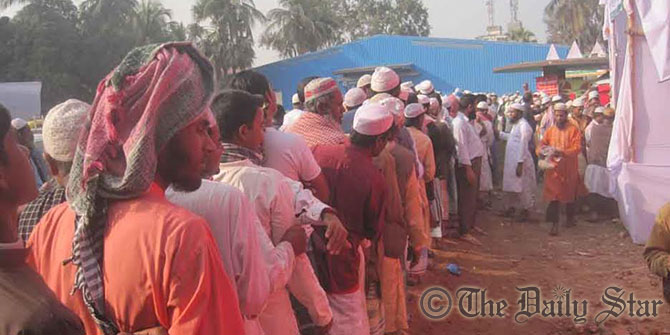Devotees queue up in front of a medical camp, set up on Munnu Textile Mill premises, to have medicare on the second day of second phase of Biswa Ijtema, the second biggest congregation of Muslims after Hajj. Photo: Star