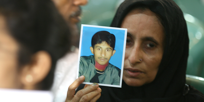 In tears the parents of victims of enforced disappearances at the Jatiya Press Club auditorium, where about 100 families of victims gathered to observe the UN's International Day of the Victims of Enforced Disappearances on August 30. Photo: Palash Khan