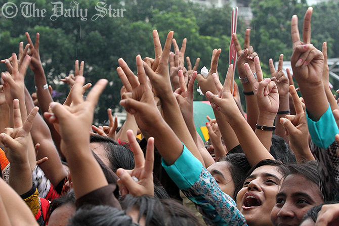 Students of Rajuk Uttara Model School and College in the capital on Wednesday rejoice their success in this year's Higher Secondary Certificate (HSC) and equivalent examinations. Photo: SK Enamul Huq