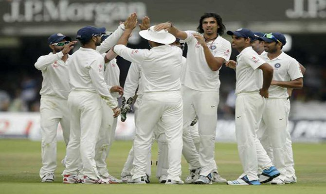 The Indian team celebrates after Ishant Sharma took the wicket of England wicketkeeper Matt Prior at Lord's cricket ground in London on Monday, July 21, 2014 . Photo: AP