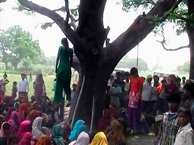 Two girls are seen hanging from a tree in a village in the northern Indian state of Uttar Pradesh on Thursday. Photo: Reuters