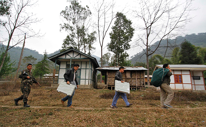 Electoral staff carry electronic voting machines (EVM) to a polling centre at Jamri village, in the northeastern Indian state of Arunachal Pradesh on Tuesday. India began in remote northeast the first phase of the world's biggest election, which will conclude on May 12. Photo: Reuters