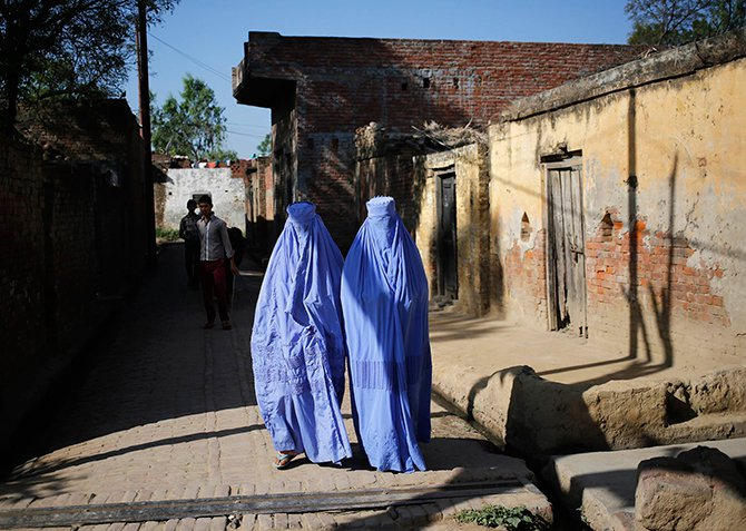 Muslim women, who were displaced by deadly religious strife last year, walk back to their relief camp after casting their vote for the general election at a polling station in Palra village in Muzaffarnagar district in the northern Indian state of Uttar Pradesh on Thursday. The election is spread out over five weeks, with voting ending on May 12. Photo: Reuters