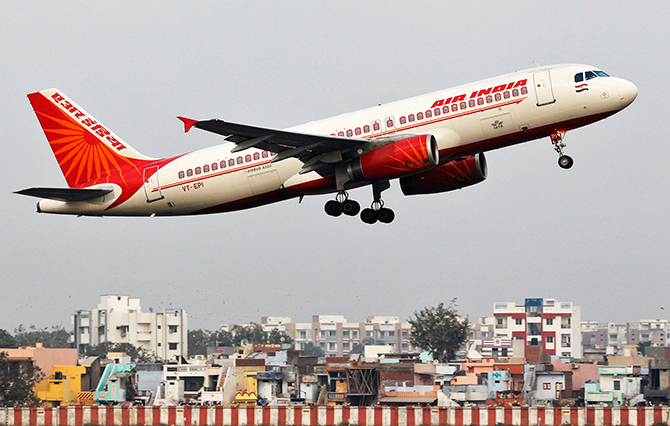 An Air India passenger plane takes off from Sardar Vallabhbhai Patel International Airport in Ahmedabad in this file photo taken January 30, 2013.  US authorities have downgraded India's aviation safety rating, citing a lack of safety oversight, meaning Indian carriers Air India and Jet Airways cannot increase flights to the US and face extra checks for existing ones.