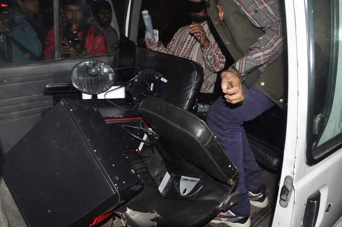 This January 16 photo shows seized computers those the law enforcers keep at their pick-up vehicle after conducting a raid at Bangla daily Inqilab office on Ram Krishna Mission Road at Motijheel in the capital.