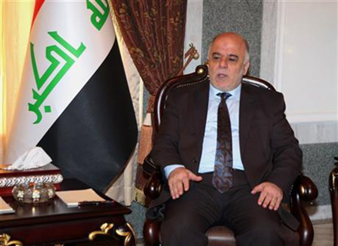 Iraqi premier-designate Haider al-Abadi meets with Pastor Farouk Yousuf in Baghdad, Iraq, Thursday, Aug. 21, 2014. Al-Abadi has until Sept. 11 to submit a list of Cabinet members to parliament for approval. Religious and ethnic minorities have called upon him to assemble an all-inclusive government. Photo: AP