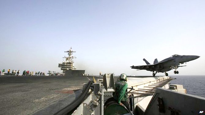 US air strikes have been launched from an aircraft carries in the Gulf. Photo: AP