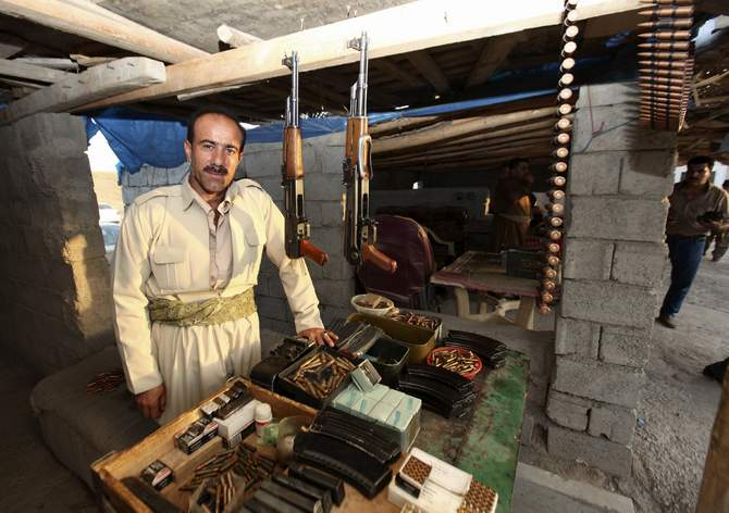 A Kurdish man displays weapons for sale at an arms market in Arbil, capital of the autonomous Kurdish region of northern Iraq, August 17, 2014. The White House said on Sunday that President Barack Obama had informed Congress he authorized US air strikes in Iraq to help retake control of the Mosul Dam, which it said was consistent with his goal of protecting US citizens in the country. Photo: Reuters