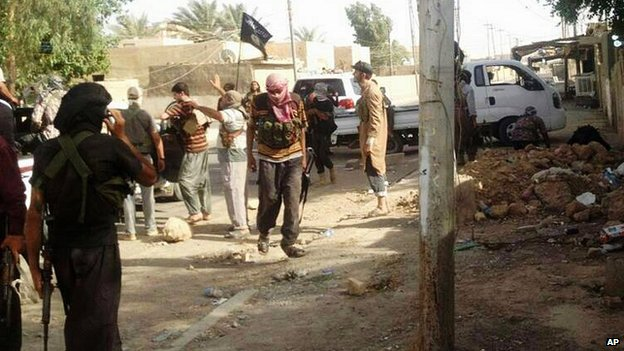 Militiamen consolidate their hold on Tikrit. Photo taken from BBC