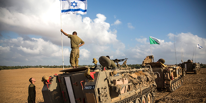 An Israeli soldier stands on top of an armored personnel carrier near the Israeli-Gaza border on July 15, 2014 near Sderot, Israel. Photo: Getty Images